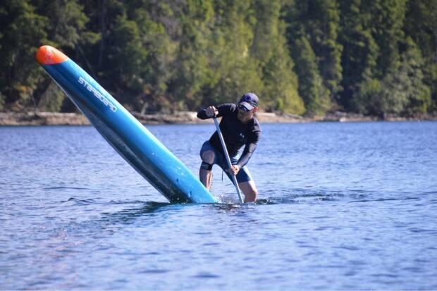 Dallas Allison hopes to break the Guinness World Record for farthest distance travelled on flat water on a stand-up paddle board on August 24.  (Dallas Allison - image credit)