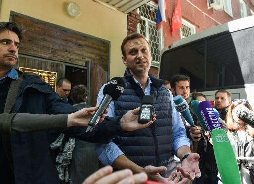 Russian opposition leader Alexei Navalny, who was detained during a May 5 anti-Putin rally, speaks to the media outside a court building in Moscow where he was sentenced to 30 days behind bars