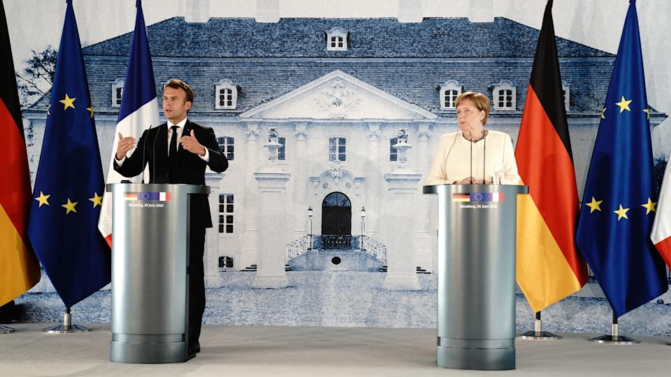 GRANSEE, GERMANY - JUNE 29: German Chancellor Angela Merkel (R) and French President Emmanuel Macron give a press conference after talks in the grounds of Schloss Meseberg on June 29, 2020 in Gransee, Germany. The German Chancellor and French President met to discuss European Union funding during the Coronavirus pandemic. (Photo by Kay Nietfeld - Pool / Getty Images)