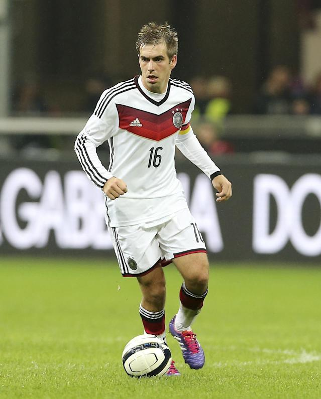 FILE - The Nov. 15, 2013 file photo shows Germany defender Philipp Lahm controling the ball during a friendly soccer match between Italy and Germany at the San Siro stadium in Milan, Italy. According to German media reports on Friday, July 18, 2014 Lahm retired from the national team - five days after he lead the team as team captain to its fourth World Cup title. (AP Photo/Antonio Calanni)