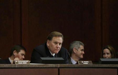 US Representative Rogers listens to testimony at House Intelligence Committee in Washington
