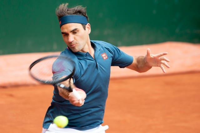 Roger Federer hits a forehand during his defeat by Pablo Andujar