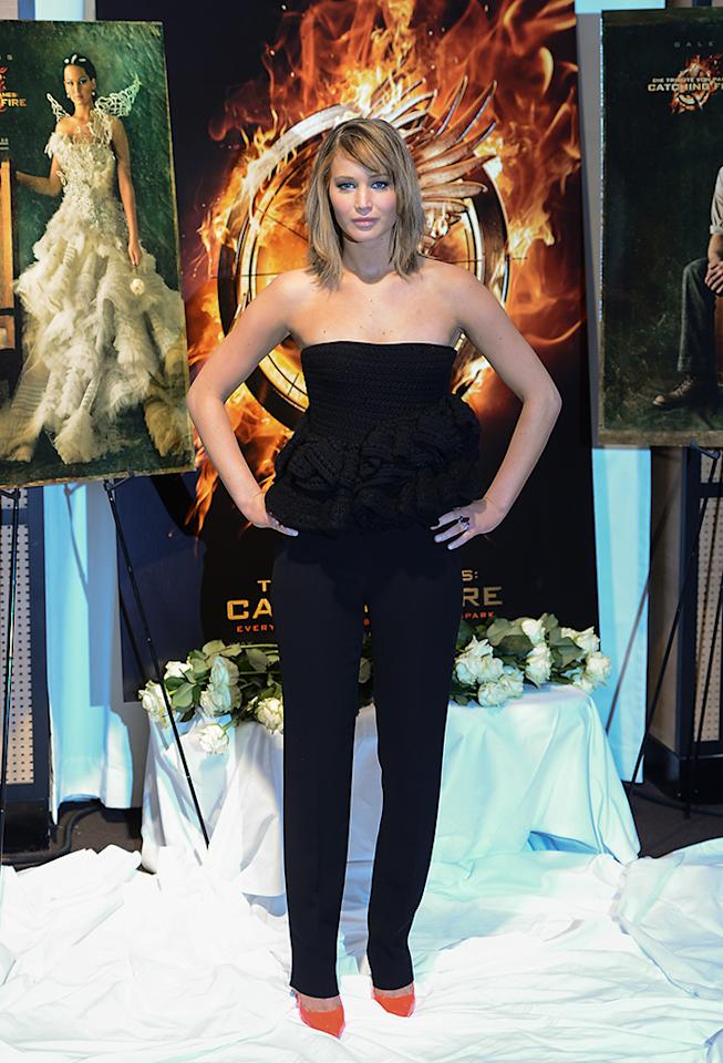 CANNES, FRANCE - MAY 18:  Actress Jennifer Lawrence poses at the 'The Hunger Games: Catching Fire' photocall during The 66th Annual Cannes Film Festival at Nespresso Beach on May 18, 2013 in Cannes, France.  (Photo by Ian Gavan/Getty Images)