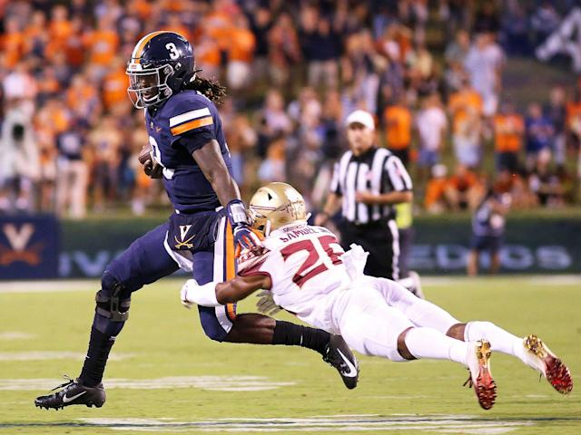 <p>Asante Samuel Jr. of Florida State tackles Bryce Perkins of Virginia in the first half during a game at Scott Stadium on Sept. 14, 2019.</p>