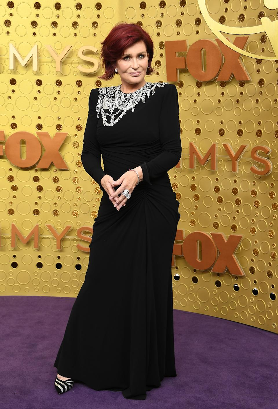 'The Talk' daytime host and infamous reality-TV mom looked elegant in an embellished black gown by Alexander McQueen. [Photo: Getty]