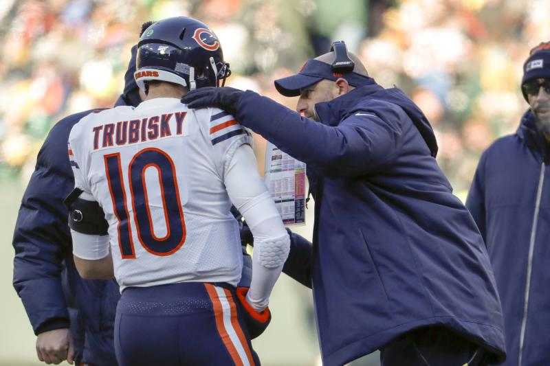 Chicago Bears head coach Matt Nagy talks to Mitchell Trubisky during the first half of an NFL football game against the Green Bay Packers Sunday, Dec. 15, 2019, in Green Bay, Wis. (AP Photo/Matt Ludtke)