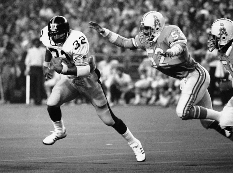 The Oilers' Robert Brazile, putting the heat on Steelers running back Franco Harris in 1978, will formally enter the Hall of Fame on Saturday. (AP)