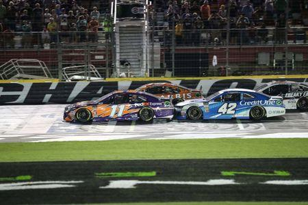 May 19, 2018; Concord, NC, USA; Monster Energy NASCAR Cup Series driver Denny Hamlin (11) and driver Daniel Suarez (19) lead a restart with Kyle Larson (42) and Kevin Harvick (4) tucked behind during the NASCAR Cup Series All-Star Open at Charlotte Motor Speedway. Kevin Harvick won the All Star Open. Mandatory Credit: Jim Dedmon-USA TODAY Sports