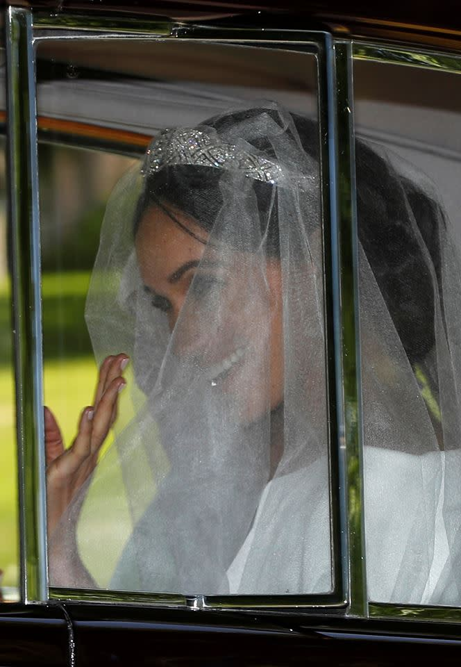 Meghan Markle in the back of the vintage Rolls-Royce (Reuters)