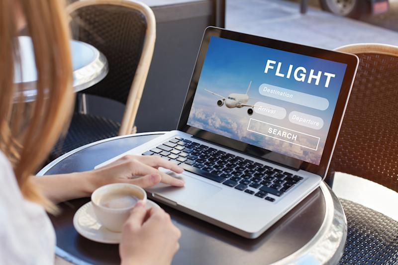 flight search on internet website, travel planning concept, airplane tickets online