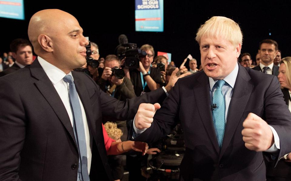 Boris Johnson and Sajid Javid are being urged to rethink plans to put up National Insurance - AFP