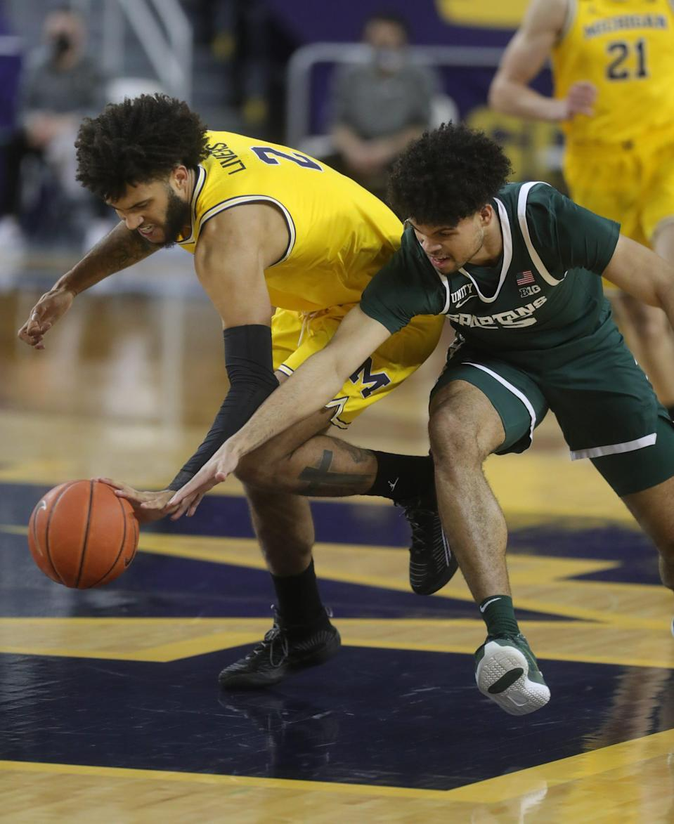 Michigan Wolverines forward Isaiah Livers defends Michigan State Spartans forward Malik Hall on Thursday, March 4, 2021 at Crisler Center in Ann Arbor.