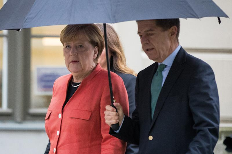 BERLIN, GERMANY - SEPTEMBER 24: German Chancellor Angela Merkel walks out of the pooling station with her husband Joachim Sauer after she casted her ballot in German federal elections on September 24, 2017 in Berlin, Germany. Merkel is seeking a fourth term and has a strong lead going into the elections over her rivals. However a significant number of voters were undecided in days prior to the election and the full outcome remains difficult to predict. (Photo by Maja Hitij/Getty Images)