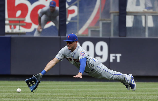 New York Mets center fielder Matt den Dekker can't make the catch on an RBI double hit by New York Yankees' Austin Romine during the fourth inning of a baseball game, Saturday, July 21, 2018, in New York. (AP Photo/Julie Jacobson)