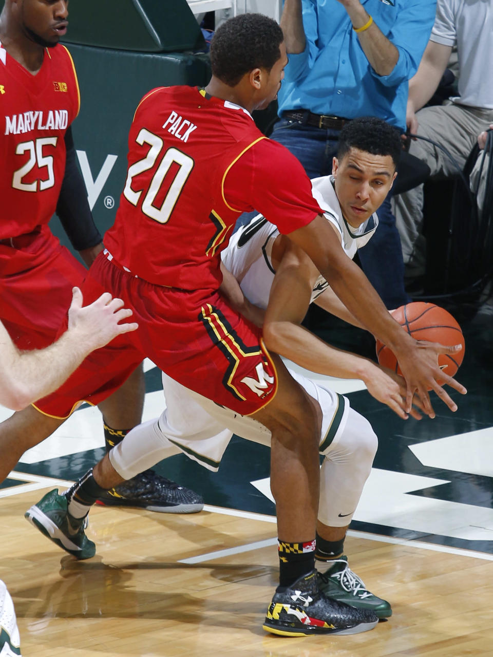Michigan State's Travis Trice, right, is pressured by Maryland's Richaud Pack (20) during the first half of an NCAA college basketball game, Tuesday, Dec. 30, 2014, in East Lansing, Mich. (AP Photo/Al Goldis)