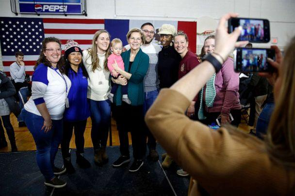 PHOTO: Democratic presidential candidate Sen. Elizabeth Warren, center, poses for photos with attendees after speaking at a campaign event, Jan. 19, 2020, in Des Moines, Iowa. (Patrick Semansky/AP, FILE)