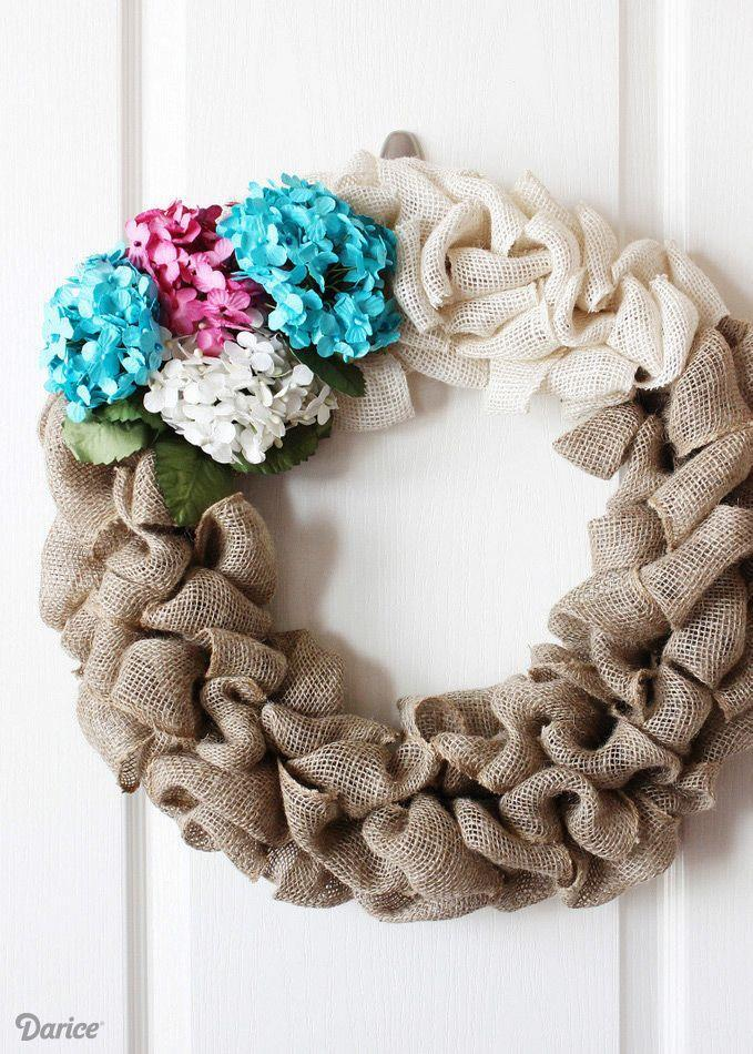 "<p>Everyone's favorite oversized blossoms combine beautifully with burlap for a door hanger visitors will love to be greeted with when they stop by for a spell.</p><p><strong>Get the tutorial at <a href=""http://blog.darice.com/basics/how-to-make-a-burlap-wreath/"" rel=""nofollow noopener"" target=""_blank"" data-ylk=""slk:Darice"" class=""link rapid-noclick-resp"">Darice</a>.</strong></p><p><a class=""link rapid-noclick-resp"" href=""https://www.amazon.com/DARICE-2914-042-Burlap-Ribbon-Natural/dp/B00CEZ8ABU/ref=sr_1_2?tag=syn-yahoo-20&ascsubtag=%5Bartid%7C10050.g.4395%5Bsrc%7Cyahoo-us"" rel=""nofollow noopener"" target=""_blank"" data-ylk=""slk:SHOP BURLAP RIBBON"">SHOP BURLAP RIBBON</a><br></p>"