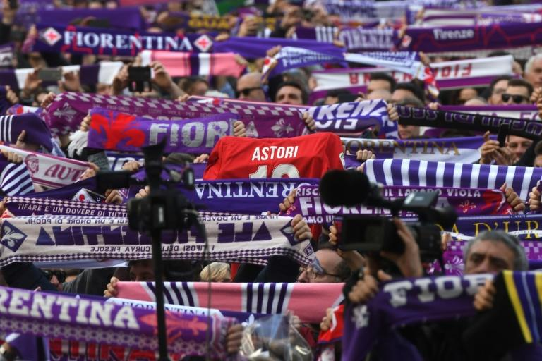 Fiorentina's supporters pay hommage to club captain Davide Astori during his funeral in Florence