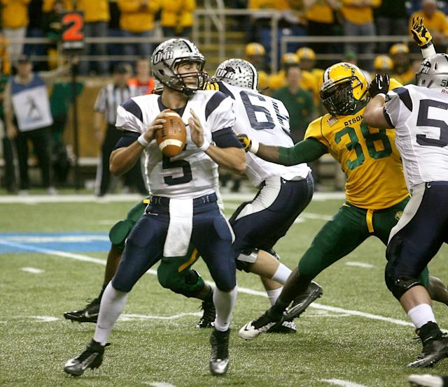 New Hampshire quarterback Sean Goldrich (5) looks to pass under pressure from North Dakota State defense during the first half of an NCAA Football Championship Subdivision semifinal game on Friday, Dec. 20, 2013, at the Fargodome in Fargo, N.D. (AP Photo/Bruce Crummy)