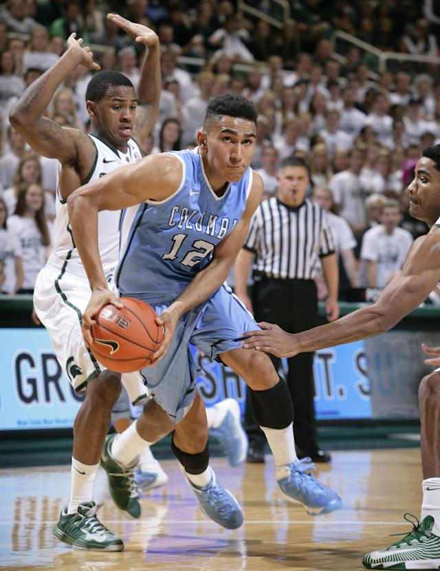 Columbia's Maodo Lo (12) drives between Michigan State's Keith Appling, left, and Gary Harris during the first half of an NCAA college basketball game Friday, Nov. 15, 2013, in East Lansing, Mich. (AP Photo/Al Goldis)