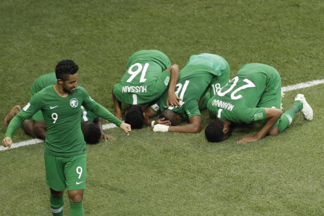 Saudi Arabia's Salem Aldawsari , second from right, celebrates with teammates after he scored his side;s winning goal during a group A match against Egypt at the 2018 soccer World Cup at the Volgograd Arena in Volgograd, Russia, Monday, June 25, 2018. Saudi Arabia won 2-1. (AP Photo/Themba Hadebe)
