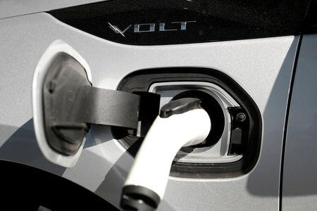 FILE PHOTO: A Chevrolet Volt plug-in hybrid vehicle is being charged at Stewart Chevrolet in Colma California