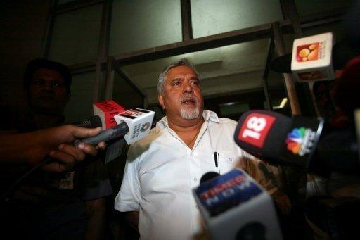 United Spirits chairman Vijay Mallya, whose business empire spanning Formula One and fertilisers has been hit by the near bankruptcy of his Kingfisher Airlines