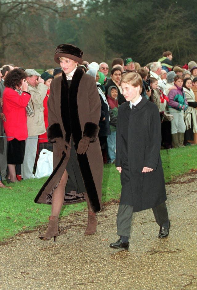 Diana with a young Prince William (PA)