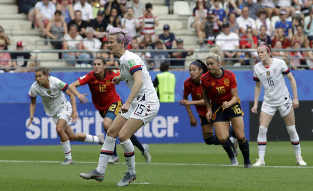 United States' Megan Rapinoe scoring the opening goal from a penalty kick during the Women's World Cup round of 16 soccer match between Spain and US at the Stade Auguste-Delaune in Reims, France, Monday, June 24, 2019. (AP Photo/Alessandra Tarantino)