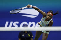 Coco Gauff serves to Naomi Osaka, of Japan, during the third round of the U.S. Open tennis tournament Saturday, Aug. 31, 2019, in New York. (AP Photo/Adam Hunger)