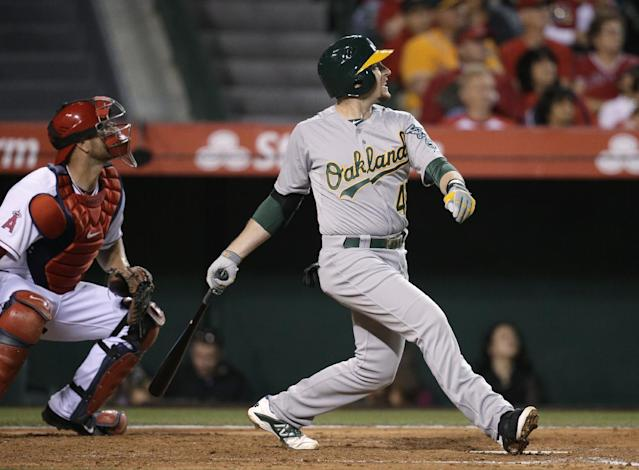 Oakland Athletics' Jed Lowrie watches his RBI double during the third inning of a baseball game against the Los Angeles Angels on Tuesday, April 15, 2014, in Anaheim, Calif. (AP Photo/Jae C. Hong)