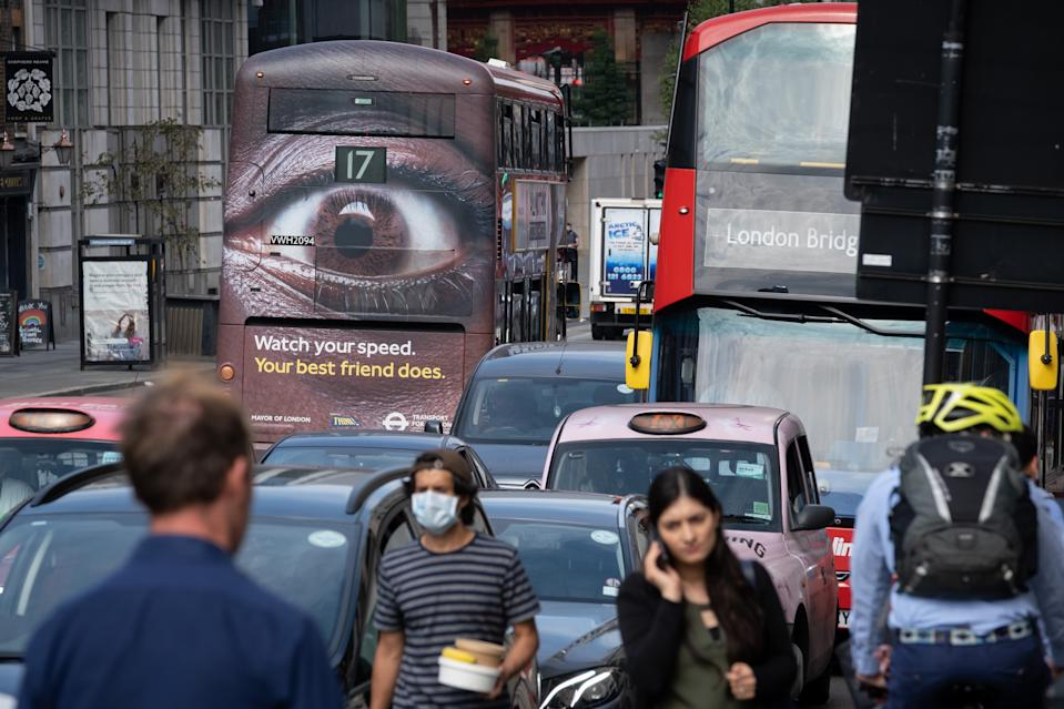Pedestrians and busy traffic on the Farringdon Road in the City of London with a London bus carrying an ad about speeding in the capital, on 16th September 2020, in London, England. (Photo by Richard Baker / In Pictures via Getty Images)