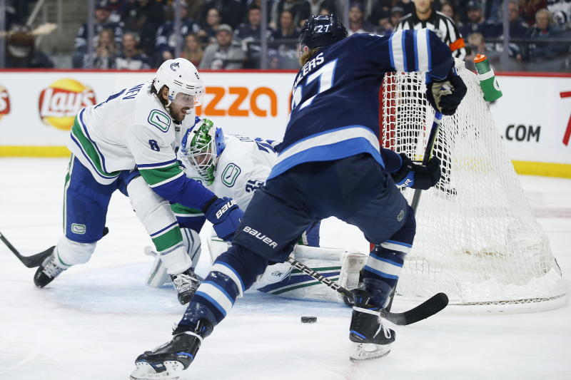 Kyle Connor has goal and assist, Jets beat Canucks 4-1