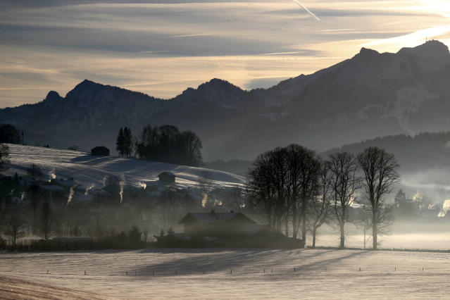 Morning fog hangs over a valley at the Alps near Miesbach, Germany, Wednesday, Jan. 16, 2019. (AP Photo/Matthias Schrader)