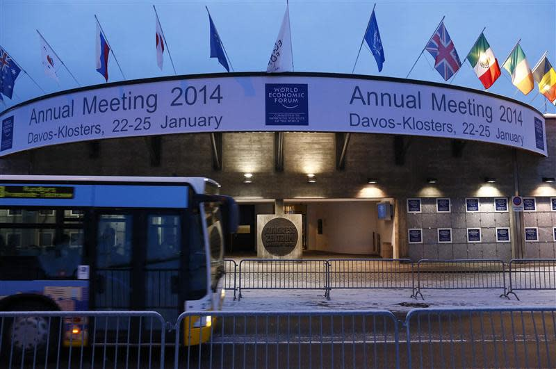 A bus drives past the entrance of the congress centre for the annual meeting of the World Economic Forum (WEF) 2014 in the early morning in Davos