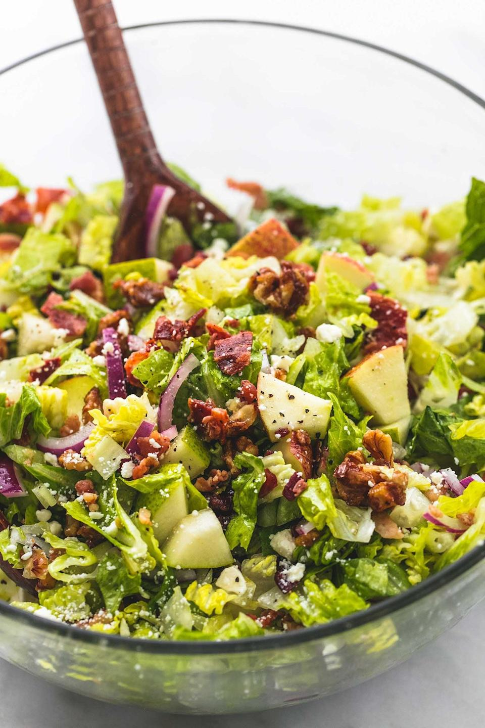 "<p>This salad's sweet and tangy apple cider dressing balances out the contrasting flavors of sweet apples, pears, and candied pecans with savory bacon and feta cheese. Just a few minutes of easy chopping yields a healthy side that anyone will love. </p> <p><strong>Get the recipe:</strong> <a href=""http://www.lecremedelacrumb.com/chopped-autumn-salad-apple-cider-dressing/"" class=""link rapid-noclick-resp"" rel=""nofollow noopener"" target=""_blank"" data-ylk=""slk:chopped Autumn salad with apple cider dressing"">chopped Autumn salad with apple cider dressing</a></p>"