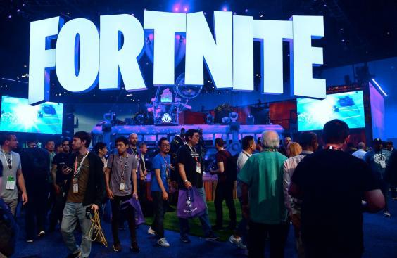 People crowd the display area for the survival game Fortnite at the 24th Electronic Expo, or E3 2018, in Los Angeles, California on on June 12, 2018 (FREDERIC J. BROWN/AFP/Getty Images)