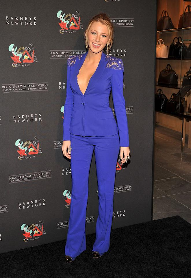 Blake Lively also stepped out for the grand opening in a rather low-cut blue Elie Saab suit. Do you think it was appropriate for the occasion? (11/21/2011)
