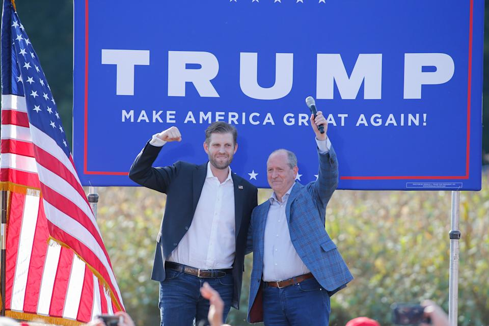 Eric Trump, left, the son of President Donald Trump, stands with Rep. Dan Bishop, R-N.C., at a campaign rally for Trump in Monroe, North Carolina, Oct. 8. (Photo: AP Photo/Nell Redmond)