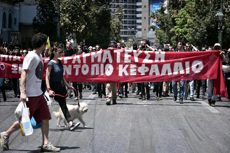 Leftist and anti establishment protesters hold a banner: 'no any negotiations with foreign or local capital' during a protest to the German embassy in Athens on May 23, 2015 (AFP Photo/Louisa Gouliamaki)
