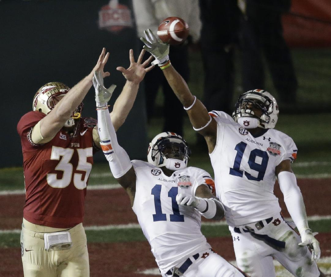 Auburn's Ryan White (19) and Chris Davis (11) break up a pass intended for Florida State's Nick O'Leary (35) during the first half of the NCAA BCS National Championship college football game Monday, Jan. 6, 2014, in Pasadena, Calif. (AP Photo/Gregory Bull)