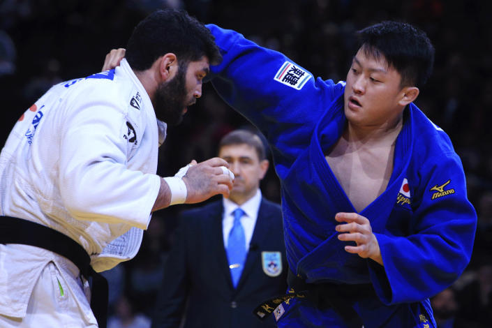 FILE - In this Sunday, Feb. 7, 2016, file photo, Or Sasson, of Israel, left, competes against Hisayoshi Harasawa, of Japan, during the men's +100 kg final at the Grand Slam Paris 2016 Judo tournament, in Paris. Judo is coming home at the Tokyo Olympics. Hisayoshi Harasawa, who lost to Teddy Riner in the Olympic final in Rio de Janeiro five years ago, was picked for another shot at the games. (AP Photo/Thibault Camus, File)