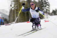 Tatyana Mcfadden of United States races during the ladies 12km cross country ski, sitting event at the 2014 Winter Paralympic, Sunday, March 9, 2014, in Krasnaya Polyana, Russia. (AP Photo/Dmitry Lovetsky)