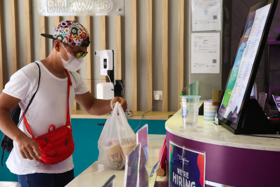 A customer buying some drinks in Chatime Putrajaya, June 14, 2021. — Picture by Choo Choy May