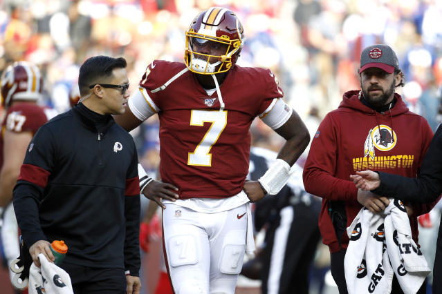 Washington Redskins quarterback Dwayne Haskins walks with trainers to a cart while being taken off the field after being sacked by New York Giants linebacker Lorenzo Carter during the second half of an NFL football game, Sunday, Dec. 22, 2019, in Landover, Md. (AP Photo/Patrick Semansky)
