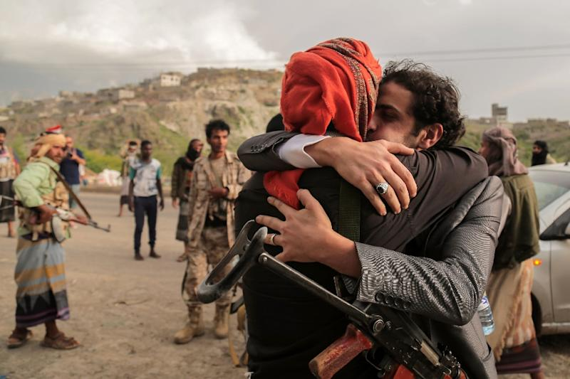 A tribesman from the Popular Resistance Committees supporting forces loyal to Yemen's president is greeted by a comrade after his release as part of a prisoner exchange with the Huthi rebels in the southwestern city of Taez on June 1, 2016