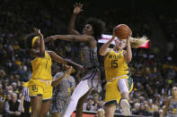 Baylor forward Lauren Cox, right, pulls down a rebound over West Virginia center Blessing Ejiofor, center, in the first half of an NCAA college basketball game, Saturday, Jan. 18, 2020, in Waco, Texas. (AP Photo/Rod Aydelotte)
