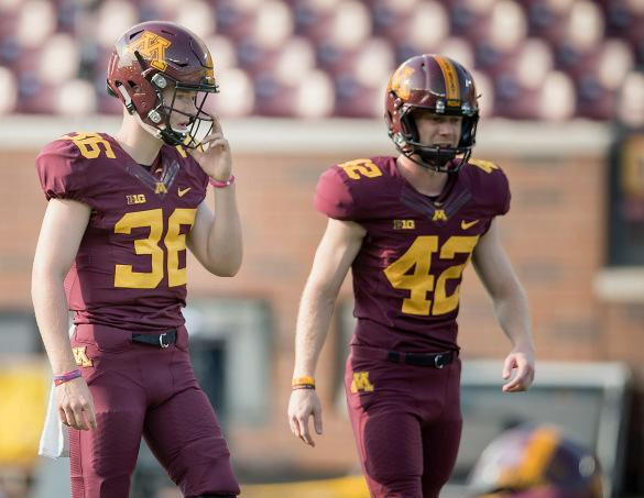 Casey O'Brien (L) stands next to a Minnesota kicker during the Gophers' spring game. (Photo credit: Casey O'Brien family)