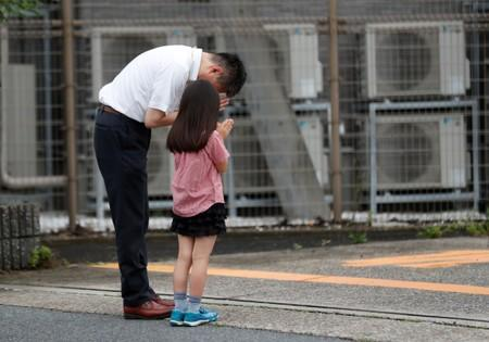 People pray for victims of the torched Kyoto Animation building in Kyoto