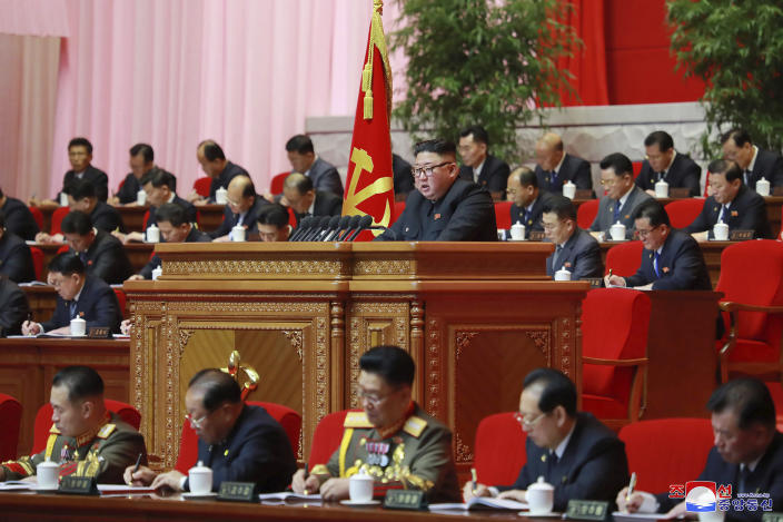 """In this photo provided by the North Korean government, North Korean leader Kim Jong Un, center, attends a ruling party congress in Pyongyang, North Korea Wednesday, Jan. 6, 2021. North Korea's ruling Workers' Party continued its landmark Congress for a second day Wednesday, state media reported early Thursday. Independent journalists were not given access to cover the event depicted in this image distributed by the North Korean government. The content of this image is as provided and cannot be independently verified. Korean language watermark on image as provided by source reads: """"KCNA"""" which is the abbreviation for Korean Central News Agency. (Korean Central News Agency/Korea News Service via AP)"""
